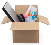 cardboard box filled with desk items